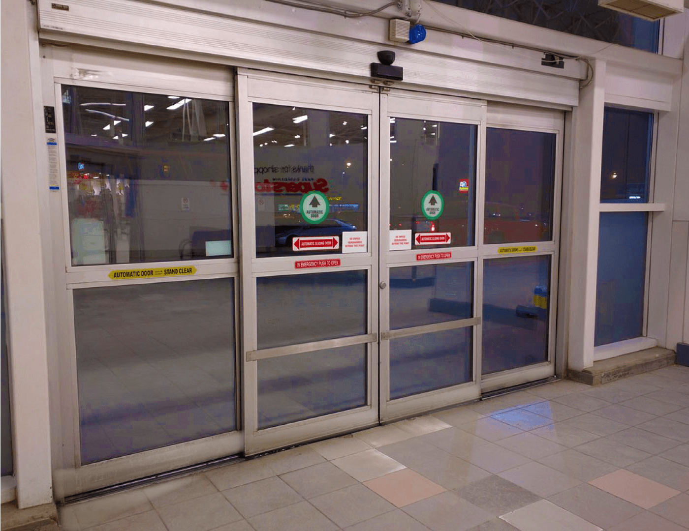automatic sliding glass doors enhancing health and safety in covid time